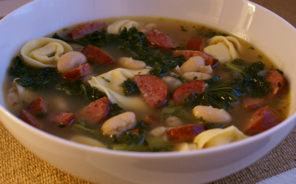 cheese tortellini soup with cannellini, kielbasa, + kale
