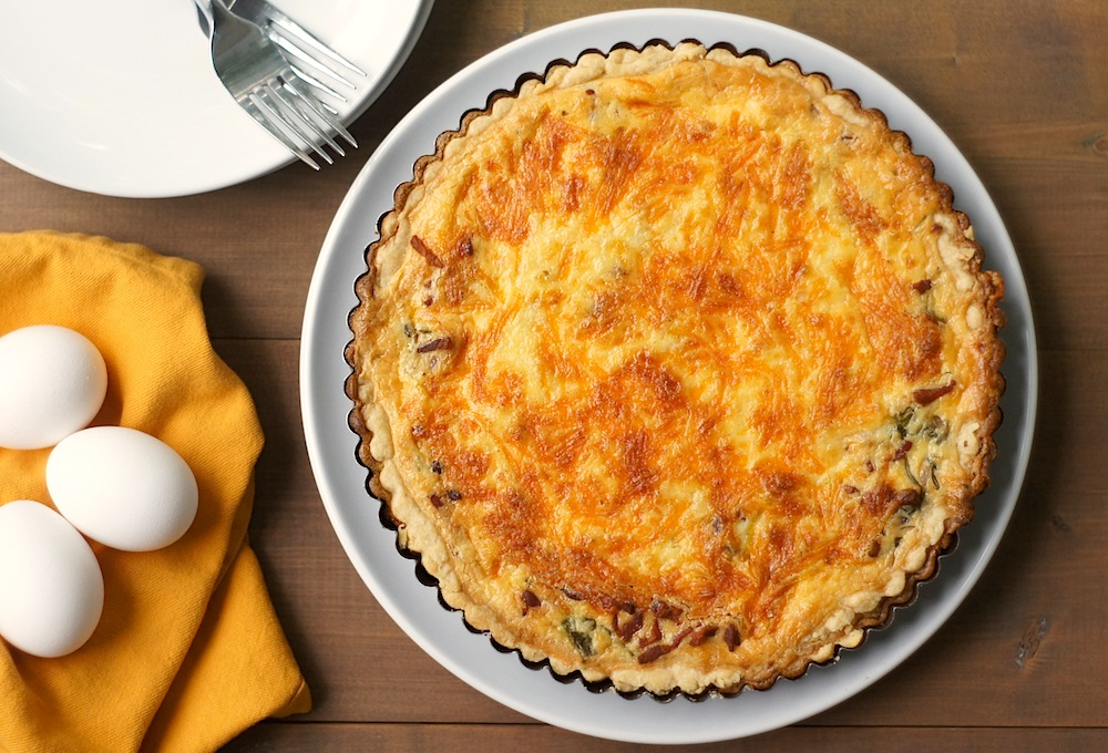 Quiche with Arugula, Bacon, + Cheddar
