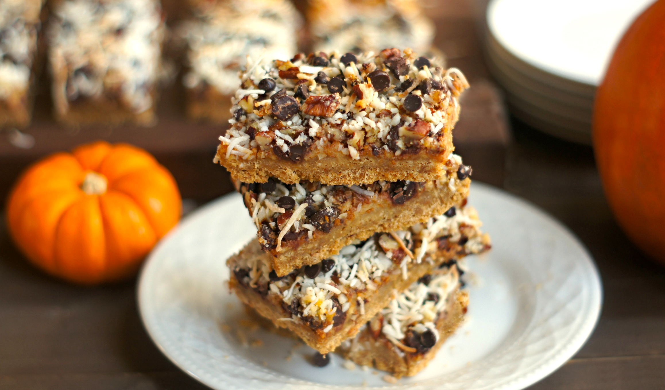 Pumpkin Magic Bars! (Seven-Layer Bars with pumpkin, apple, coconut, chocolate chip, pecans, sweetened condensed milk, + graham crackers) | FearlessHomemaker.com