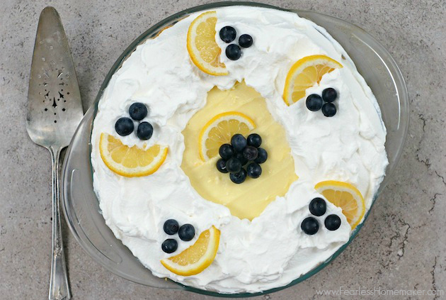 Lemon-Blueberry Cream Pie: Citrusy, bright lemon cream pie full of fresh blueberries, whipped cream + a graham cracker crust. A perfect summertime pie! www.FearlessHomemaker.com